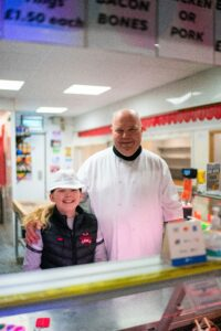 Colin Mackenzie of C.A.M. Family Meats with his daughter Ruby