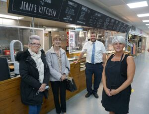 (from left) group members Ann Goodison and Josie Aspland, market manager David Harris and Jean's Kitchen manager Louise Matthews